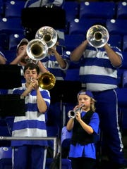 Ten-year-old Eli Deml plays his toy trumpet with the MTSU pep band during the game against Florida Atlantic on Saturday, March 4, 2017.