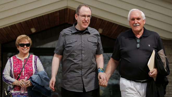 Mental health advocates Bob, right, and Sue White, of Clarkston, leave a press conference on Tuesday, April 18, 2017, with their 47-year-old son, Fred, after speaking to journalists and fellow advocates about recent mental health care legislation at the Mental Health Care Association of Michigan offices in Okemos.