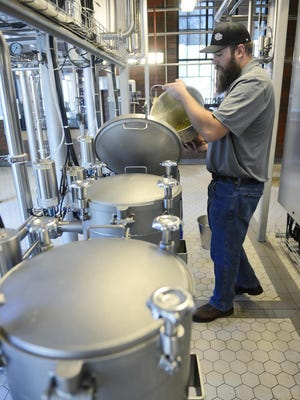A brewer works at Cold Spring Brewing Co. in this file photo from 2015.