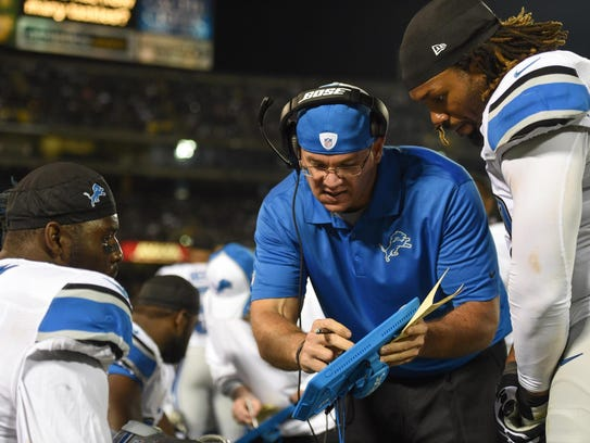 Detroit Lions defensive line coach Kris Kocurek instructs