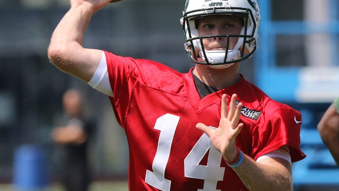 Quarterback Sam Darnold throws an out pass.