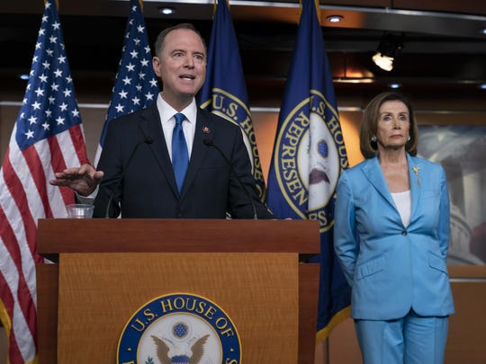 House Intelligence Committee Chairman Adam Schiff, D-Calif., joins Speaker of the House Nancy Pelosi, D-Calif., right, at a news conference as House Democrats move on depositions in the impeachment inquiry of President Donald Trump, at the Capitol in Washington, Wednesday, Oct. 2, 2019. In an unusual show of anger today, Trump defended his phone call with the president of Ukraine and said Adam Schiff may have committed treason by investigating the matter. (AP Photo/J. Scott Applewhite)