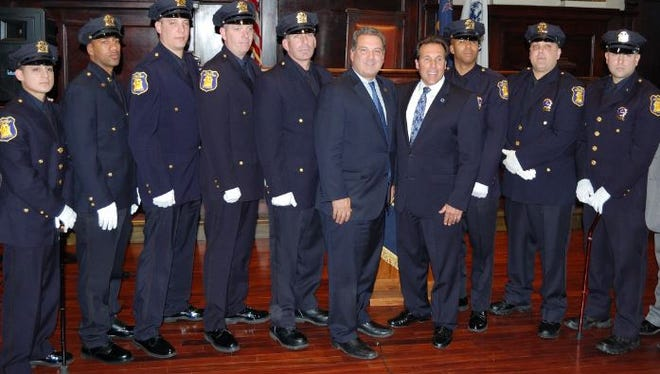 The Yonkers Police Department recently promoted eight members. From left with their new ranks are Sgt. Gabriel Barahona, Sgt. Charles Walker, Sgt. James Diodati, Sgt. Dennis Casey, Sgt. Chris Balezentis, Mayor Mike Spano, Police Commissioner Charles Gardner, Detective Javier Lugo, Detective Robert Santabello and Detective William Celestino.
