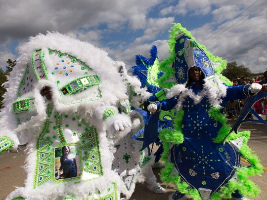 Members of the Exit 87 Mardi Gras indians from Rayne perform during the 13th Annual African American History Parade along Willow Street in Lafayette Feb. 28, 2016.
