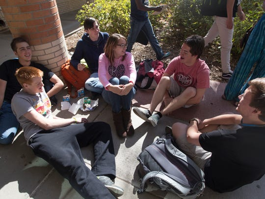Students spend their lunch time out front of Poudre