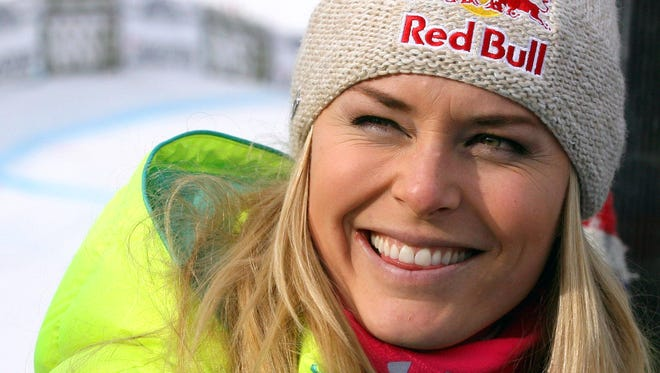 Lindsey Vonn smiles after winning a World Cup super-G, in Cortina d'Ampezzo, Italy, Monday.