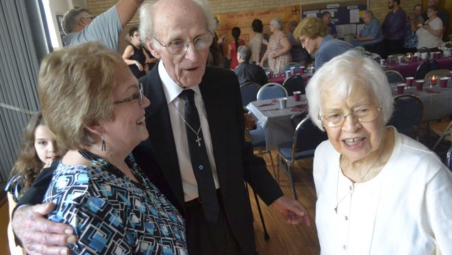 Bronnie Stroud, middle, and his wife Annabelle are greeted by well-wishers, including Melodee Lujano, left, of Austin, Texas, during a post-service reception Sept. 6 to honor the Strouds for their 70th wedding anniversary at St. Matthew Orthodox Church in Green Bay. As a child, Lujano attended Assembly of God Church in Tomah, where Bronnie was pastor in the early 1960s.