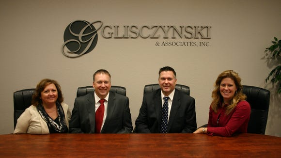 Staff members of the Kronenwetter office of Glisczynski & Associates include, from left to right, Colleen Smiley (office manager), Michael Marcell (investment advisor representative), Patrick Marcell (investment advisor representative), and Alyssa Marcell (personal assistant to Patrick Marcell).