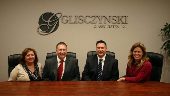 From left to right are Office Manager Colleen Smiley, Investment Adviser Representative Michael Marcell, Investment Adviser Representative Patrick Marcell and Personal Assistant Alyssa Marcell.