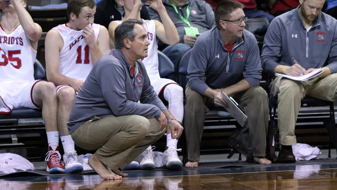 SF Lincoln Head Coach, Jeff Halseth goes shoeless during Saturday's game at the Samaritan's Feet Barefoot Classic at the Pentagon