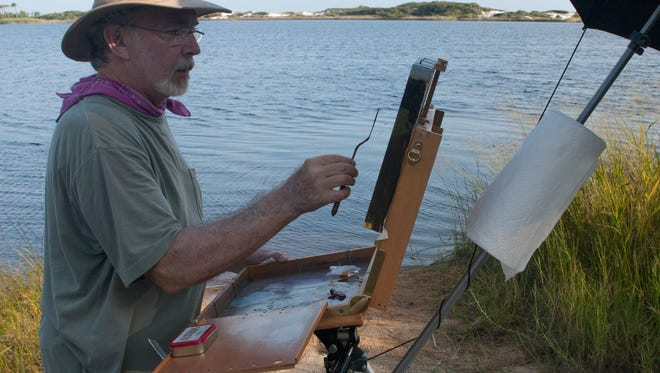 Plein air painter Stephen Smith works outside in Grayton Beach, Florida.