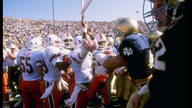 A fight breaks out before a game between the Miami Hurricanes and the Notre Dame Fighting Irish at Notre Dame Stadium. Notre Dame won the game 31-30.