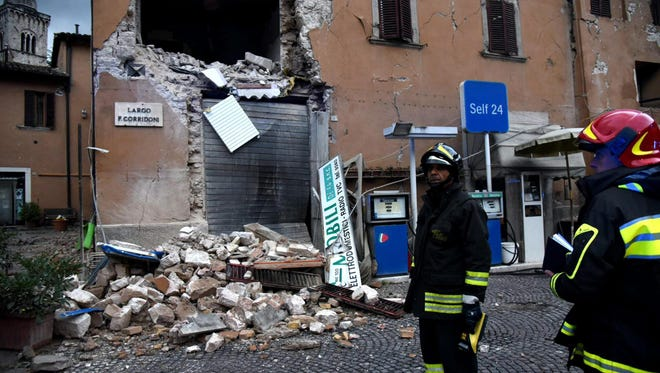 A view of a damaged building as rescue teams operate at the first light of the day in the aftermath of two strong earthquakes hitting the region, in Visso, Marche region, central Italy, Oct. 17, 2016.