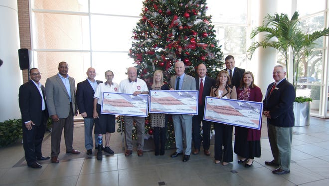 Stan Connally, Chairman, president and CEO of Gulf Power, along with members of the energy company's service organization, Transformers, presented checks totaling more than $91,000 to local veterans organizations.