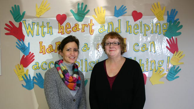Pictured here are Shelley Nelson, left, the referral and communication specialist at Childcaring Inc., and Ruth Krueger, a volunteer from Wisconsin Rapids.  Shelley often calls upon Ruth to help out!