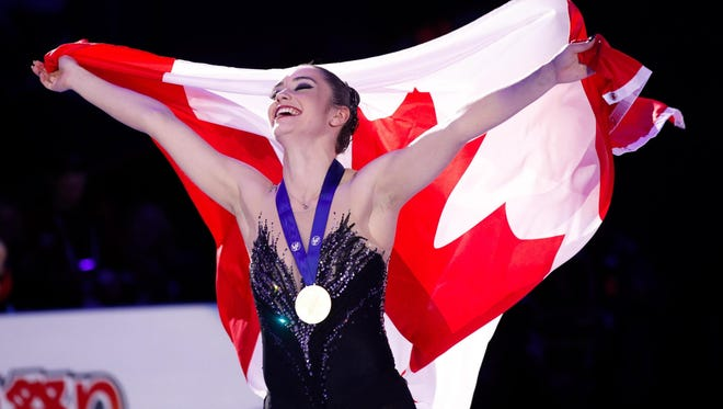 Kaetlyn Osmond of Canada celebrates her gold medal World Figure Skating Championships.