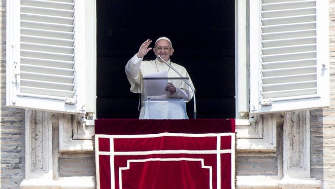 Pope Francis blesses the faithful  from the window of his office in St. Peter's Square, Vatican City, on May 20, 2018.