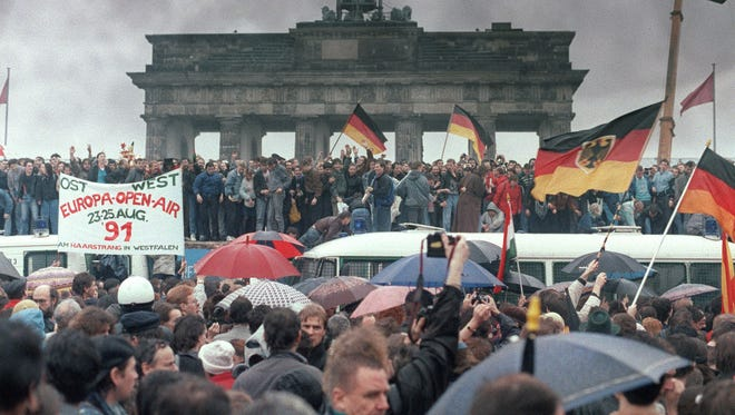 This image from en on December 22, 1989, shows people from East and West Germany gathering for the opening of the Brandenburg Gate in Berlin.