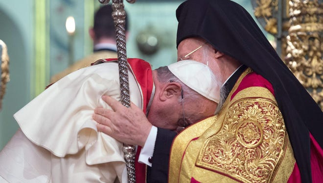Pope Francis, left, is embraced by Ecumenical Orthodox Patriarch Bartholomew I, right, on Sunday, Nov. 30, the pope's final day of a three-day trip to Turkey.EPA/OSSERVATORE ROMANO PRESS OFFICE  HANDOUT EDITORIAL USE ONLY/NO SALES ORG XMIT: or02