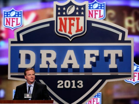 nfl franchise tag how many rounds in nfl draft