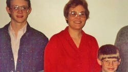 Chad White (left) with his mother and brother, Jason