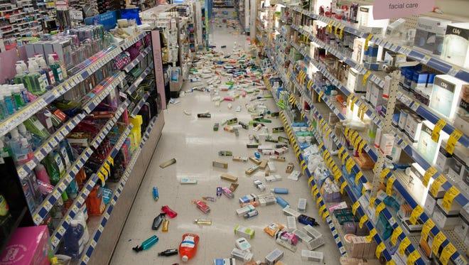 Merchandise is strewn across the floor in a La Habra Walgreens following an earthquake on Friday.