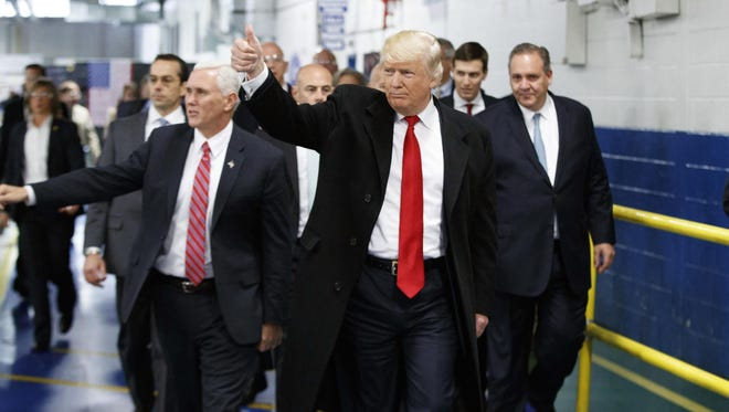 President-elect Donald Trump and his running mate, Mike Pence, visited Carrier Corp. in Indianapolis with United Technologies executives on Dec. 1. 2016.