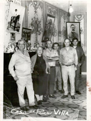 The photo that was taken on October 19, 1970 at the Pancho Villa Museum in Chihuahua City, Mexico shows Villa's widow, second from left, Dona Maria Luz Corral de Villa and Jose and Victor Chavez at right in the background. The three men in front were not identified, but were part of the tour Dona Maria Luz gave that day.
