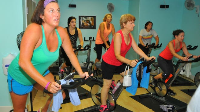 Michelle Mulak took a cycle class, or spin class, at the Suntree YMCA with instructor Cindy Harrowsmith.