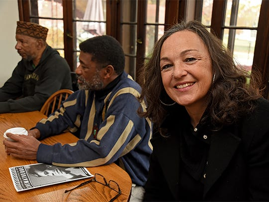 Auburn Sheaffer Sandstrom, now a doctoral candidate at Cleveland State University, meets with the African Wisdom Circle, an informal weekly coffee-house group in University Heights, Ohio, that includes James E. Page, left, and John Omar. The group discusses issues of race, gender and the meaning of being human.