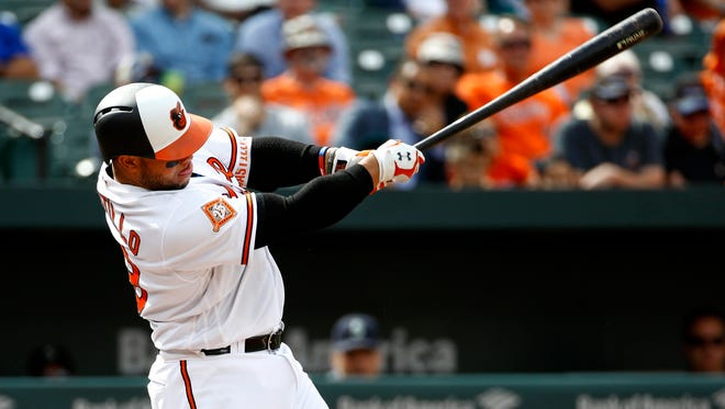 Baltimore Orioles' Welington Castillo doubles in the second inning of a baseball game against the Seattle Mariners in Baltimore, Wednesday, Aug. 30, 2017. Chris Davis scored on the play. Baltimore won 8-7. (AP Photo/Patrick Semansky)