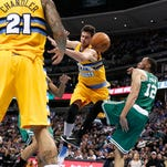 Jan 23, 2015; Denver, CO, USA; Denver Nuggets forward Wilson Chandler (21) watches as forward Danilo Gallinari (8) gets caught up with Boston Celtics forward Tayshaun Prince (12) in the second quarter at Pepsi Center. Mandatory Credit: Isaiah J. Downing-USA TODAY Sports