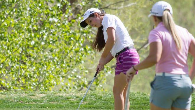 Desert Hills' Kyla Smith makes a putt during the Region 9 tournament at Sunbrook.