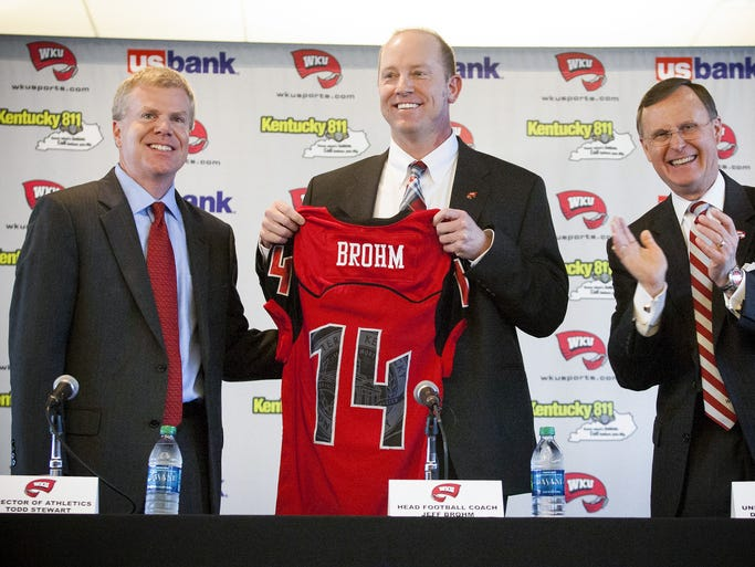 Western Kentucky University Director of Athletics Todd Stewart, left, and WKU President Gary Ransdell, right, announce Jeff Brohm, center, as the new WKU football coach during a news conference, Friday, Jan. 10, 2014, in Bowling Green, Ky.