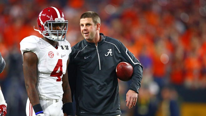 Former Alabama wide receivers coach Billy Napier talks with wide receiver Daylon Charlot during the game against the 2016 CFP National Championship at University of Phoenix Stadium against the Clemson Tigers.