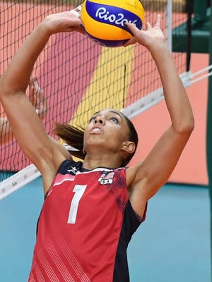 Setter Alisha Glass (Leland) and the United States take on Serbia in a semifinal at noon Thursday.