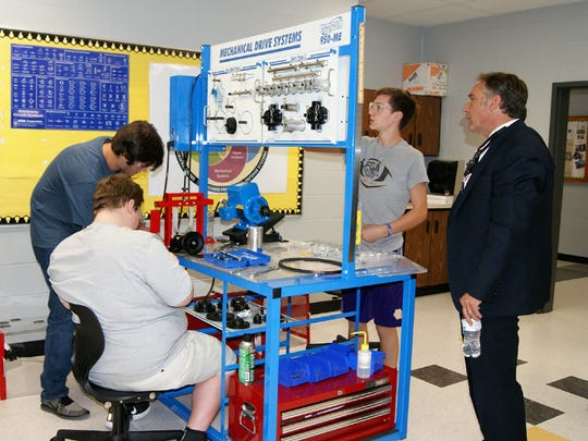 State and school leaders  visit the Mechatronics lab at Fairview High School.
