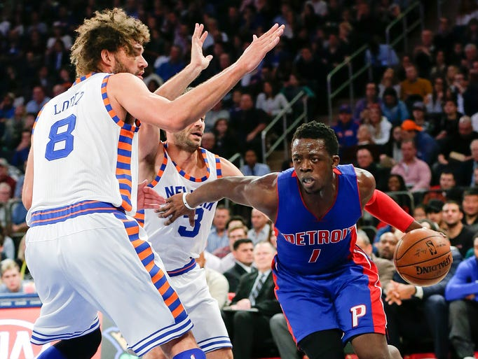 Detroit Pistons' Reggie Jackson (1) drives past New