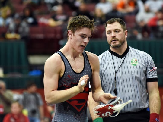 Sheridans's Noah Barnett claps his hands after winning his seventh place match at the Division II state tournament on Saturday at Value City Arena. Barnett pinned Parma Padua Franciscan's Sam LoFaso in 4:20.