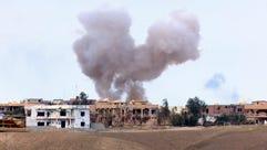 epa04687696 Smoke rises during fighting between Iraqi