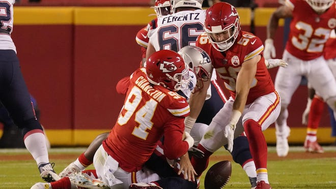 New England Patriots quarterback Brian Hoyer, center, fumbles as he is tackled by Kansas City Chiefs defensive end Taco Charlton (94) and linebacker Ben Niemann (56) during the second half of Monday's game in Kansas City. Niemann recovered the fumble.