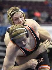 Delone Catholic's Brady Repasky wrestles Dan Kuhn of