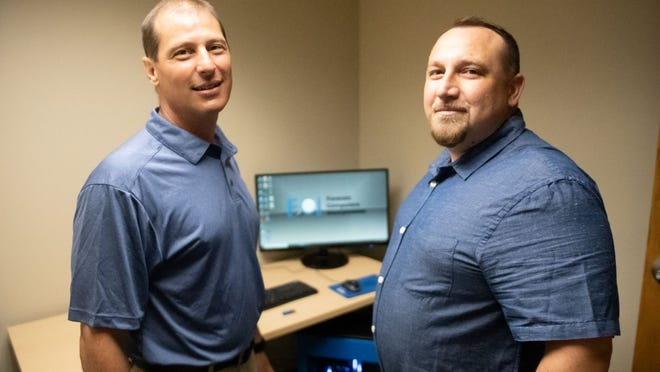 Roberts Wesleyan College opens its Digital Forensics Lab to assist with data extraction and recovery, forensic imaging, and virus and malware scanning. Pictured, from left, are Joseph Testani, director of the Justice & Security Institute, and Robert Price, director of the Forensic Computer Lab.