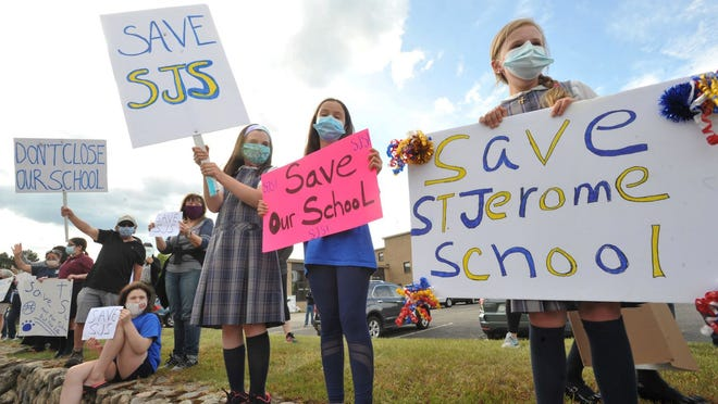 St. Jerome School students and parents protest the Boston Archdiocese proposed closing of the North Weymouth school, Tuesday, June 2, 2020. Tom Gorman/For The Patriot Ledger