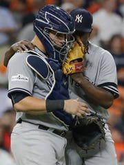 New York Yankees starting pitcher Luis Severino talks to catcher Gary Sanchez during the fifth inning of Game 6 of baseball's American League Championship Series against the Houston Astros Friday, Oct. 20, 2017, in Houston. Severino didn't make it through the inning.