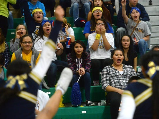 The Box Elder student section cheers its team on against the Tri-Cities Titans during the Northern C Divisional Tournament in the Four Seasons Arena on Wednesday.