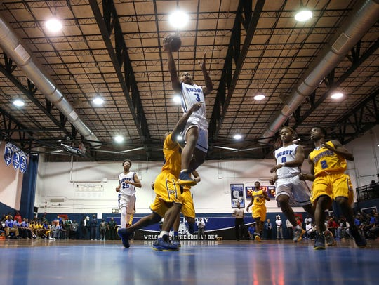 Godby's Montreal Edwards lays the ball up against Rickards'