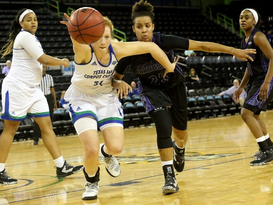 Islanders' Emma Young reaches for the loose ball against Central Arkansas on Saturday, Jan. 14, 2017, at the American Bank Center in Corpus Christi.