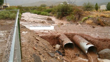 Rain water drains into parts of Arroyo and Dry Canyon during this heavy flood from 2005.