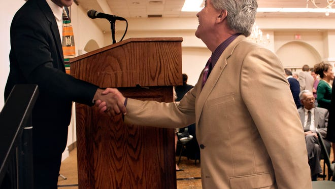 Donald Pope-Davis, dean of the College of Education at New Mexico State University, left, greets Fernando R. Macias, chief district judge of the 3rd Judicial District, on Monday during the eighth annual MLK breakfast hosted by the Doña Ana County NAACP.